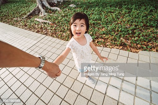 First person view of dad holding daughter's hand