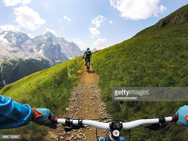 First Person View of man Mountain Biking in the Dolomites, South Tyrol, Italy