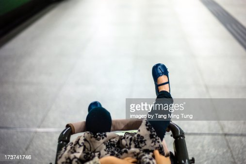 First person view of toddler girl in stroller