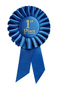 First place award, rosette isolated on white background
