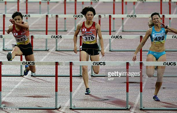 First place Ayako Kimura from Japan and second placed from Khazakistan Anastassiya Soprunov Gebregeiorges cross the final hurdle in the women's 100...