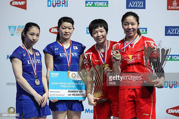 First place Chen Qingchen and Jia Yifan of China pose with second place Ayaka Takahashi and Misaki Matsutomo of Japan after women's doubles final...