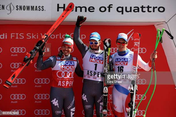 First place Dominik Paris of Italy second place Peter Fill of Italy and third place Carlo Janka of Switzerland pose on the podium after the Men's...