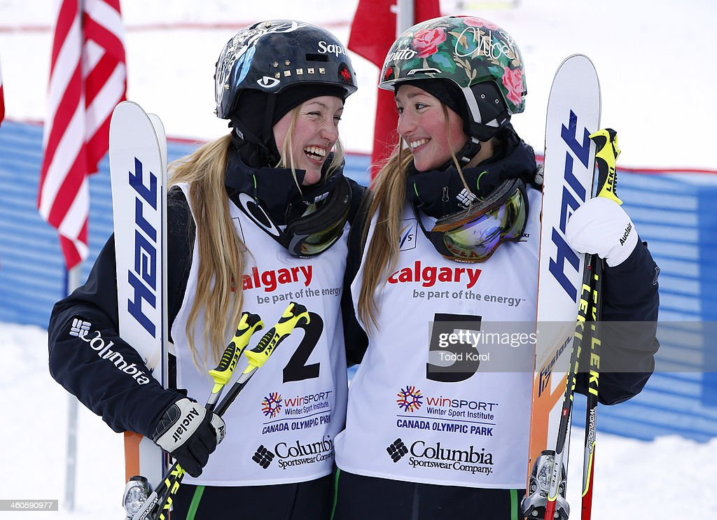First place finisher <a gi-track='captionPersonalityLinkClicked' href=/galleries/search?phrase=Justine+Dufour-Lapointe&family=editorial&specificpeople=7469946 ng-click='$event.stopPropagation()'>Justine Dufour-Lapointe</a> (L) and sister Chloe Dufour-Lapointe, third place, smile at each other during the women's moguls finals at the FIS Freestyle Ski World Cup January 4, 2014 in Calgary, Alberta, Canada.