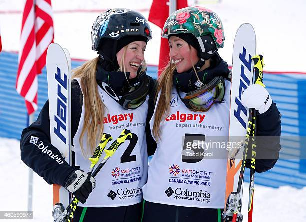 First place finisher Justine DufourLapointe and sister Chloe DufourLapointe third place smile at each other during the women's moguls finals at the...