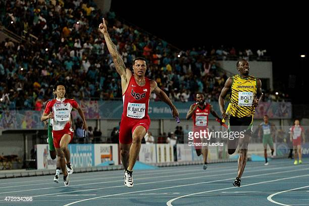 First place finisher Ryan Bailey of the United States second place finisher Usain Bolt of Jamaica and third place finisher Kotaro Taniguchi of Japan...