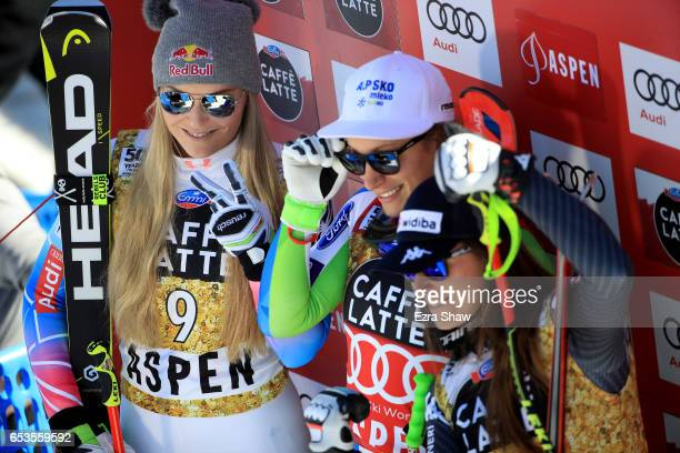 First place Ilka Stuhec of Slovenia second place Lindsey Vonn of the United States and third place Sofia Goggia of Italy celebrates after finishing...