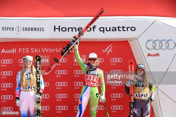 First place Ilka Stuhec of Slovenia second place Lindsey Vonn of the United States and third place Sofia Goggia of Italy pose on the podium after...