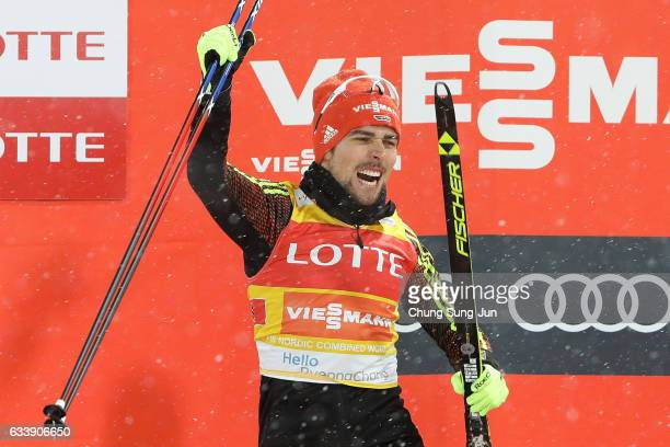 First Place Johannes Rydzek of Germany celebrates during the flower ceremony in the Individual Gundersen 10km Large Hill during the FIS Nordic...