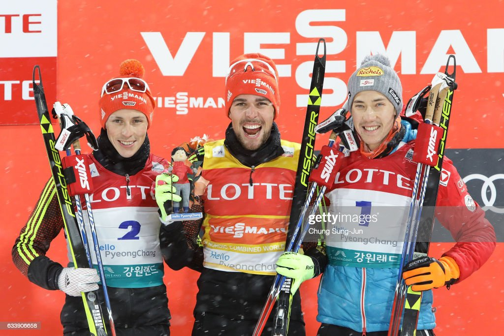 First Place Johannes Rydzek of Germany (C), second place Eric Frenzel of Germany (L) and third place Mario Seidl (R) of Austria celebrate during the flower ceremony in the Individual Gundersen 10km Large Hill during the FIS Nordic Combined World Cup presented by Viessmann - Test Event For Pyeongchang 2018 Olympic Winter Games at Alpensia Cross-Country Centre on February 5, 2017 in Pyeongchang-gun, South Korea.