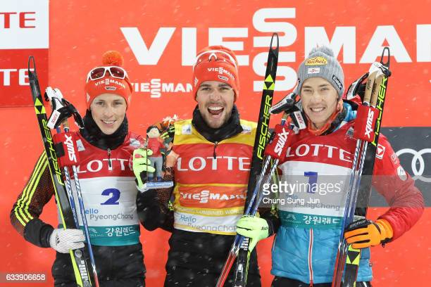 First Place Johannes Rydzek of Germany second place Eric Frenzel of Germany and third place Mario Seidl of Austria celebrate during the flower...