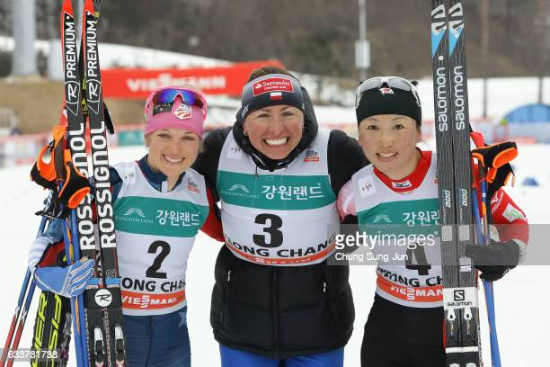 First Place Justyna Kowalczyk of Poland second place Elizabeth Stephen of the United States and third place Masako Ishida of Japan celebrate after...