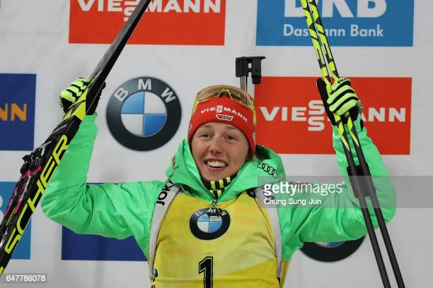 First place Laura Dahlmeier of Germany celebrates during the flower celemony for the Woman 10km Pursuit during the BMW IBU World Cup Biathlon 2017 a...