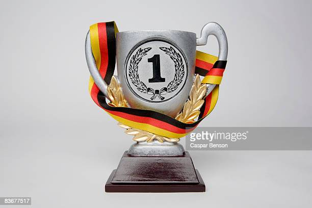 First place trophy cup wrapped in a sash with the German flag colors