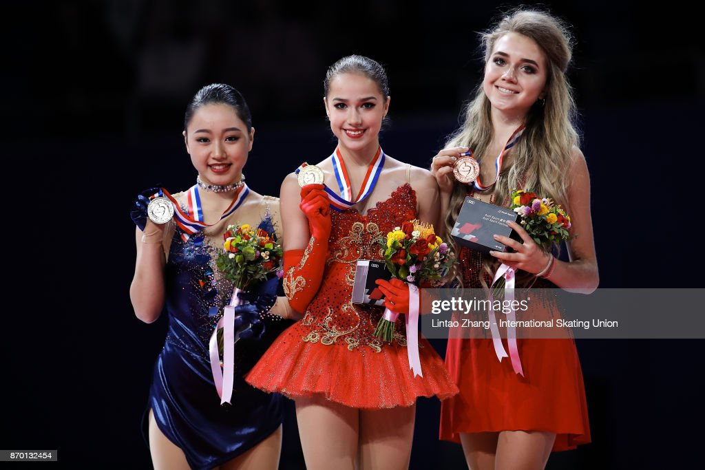 First place winner Alina Zagitova of Russia (C), second place winner Wakaba Higuchi of Japan (L) and third place winner Elena Radionova of Russia(R) pose on the podium during the medals ceremony on day two of Audi Cup of China ISU Grand Prix of Figure Skating 2017 at Beijing Capital Gymnasium on November 4, 2017 in Beijing, China.