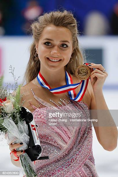 First place winner Elena Radionova of Russia pose on the podium during the medals ceremony of the Ladies Free Skating on day two of Audi Cup of China...