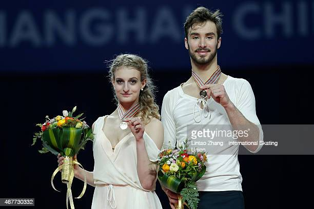 First place winner Gabriella Papadakis and Guillaume Cizeron of France pose on the podium after the medals ceremony of the Ice DanceFree Dance on day...
