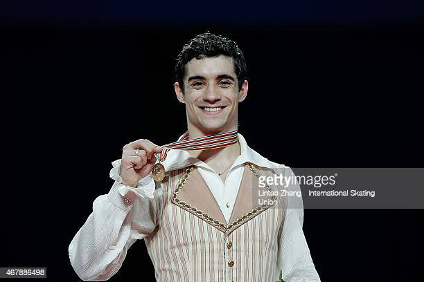 First place winner Javier Fernandez of Spain pose on the podium after the medals ceremony of the Ice DanceMan Free Skating Program on day four of the...