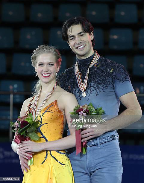 First place winner Kaitlyn Weaver and Andrew Poje of Canada pose on the podium after the medals ceremony of the Ice Dance on day two of the ISU Four...
