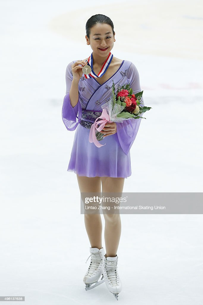First place winner Mao Asada of Japan pose on the podium after the medals ceremony of the Ladies Short Program on day two of Audi Cup of China ISU Grand Prix of Figure Skating 2015 at Beijing Capital Gymnasium on November 7, 2015 in Beijing, China.