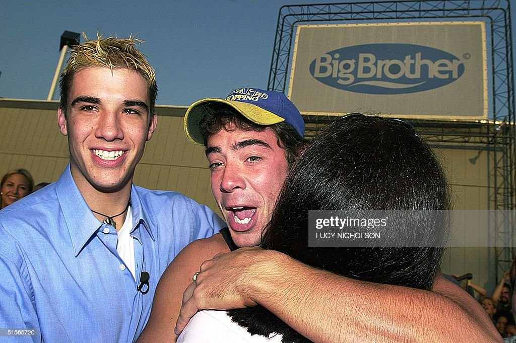 US first place winner of 'Big Brother' reality television show Eddie McGee is greeted by his mother Denise McGee and his brother Robert McGee after...