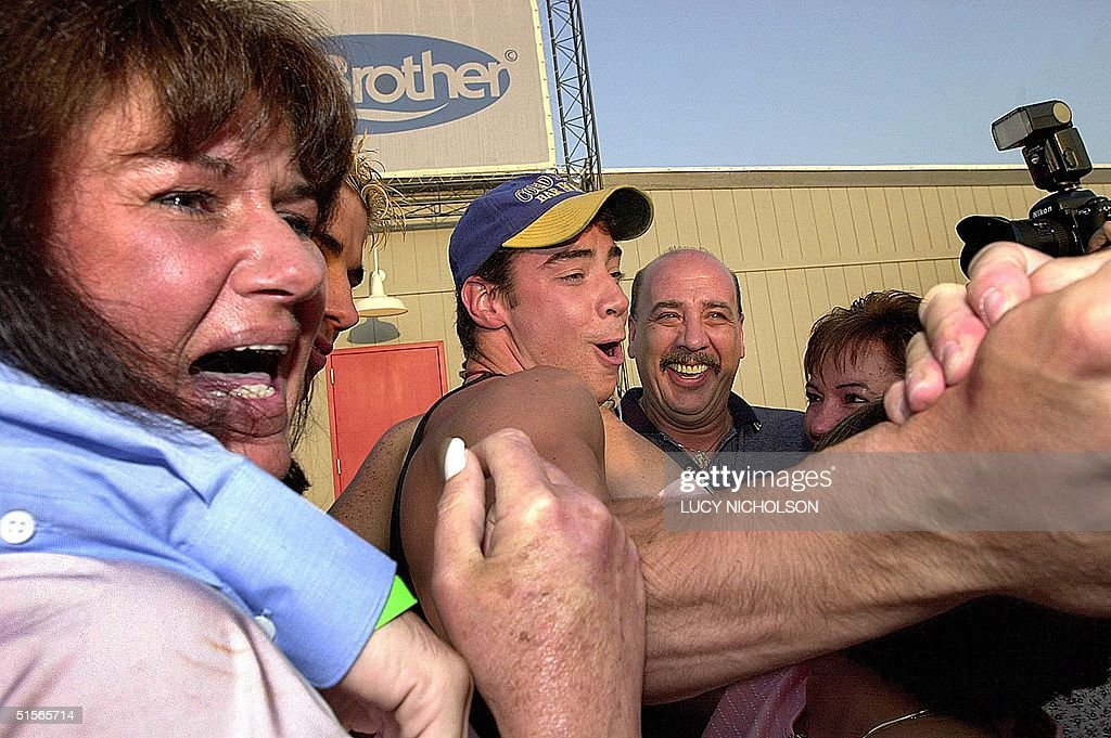 First place winner of the 'Big Brother' reality television show Eddie McGee meets his mother Denise McGee and his father Edward McGee after exiting...