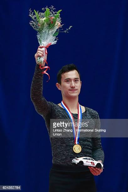 First place winner Patrick Chan of Canada pose on the podium during the medals ceremony of the Men Free Skating on day two of Audi Cup of China ISU...