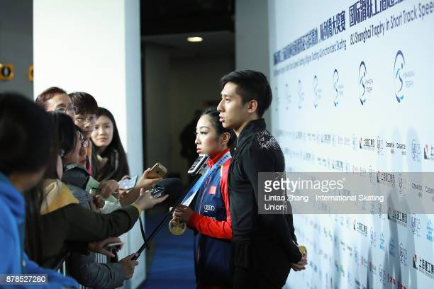 First place winner Sui Wenjing and Han Cong of China accept media interviews after win the Pairs Free skating duirng the 2017 Shanghai Trophy at the...