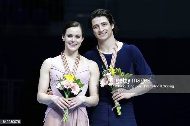 First place winner Tessa Virtue and Scott Moir of Canada pose on the podium after the medals ceremony of the Ice Dance during ISU Four Continents...
