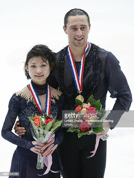 First place winner Yuko Kavaguti and Alexander Smirnov of Russia pose on the podium after the medals ceremony of the Pairs Short Program on day two...