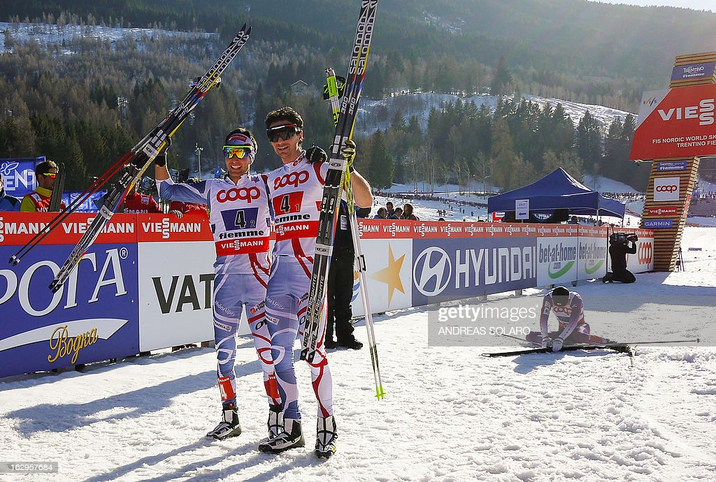 First place winners Jason Lamy Chappuis (L) and Sebastian Lacroix of France celebrate near fourth placed Akito Watabe of Japan (R) on March 2, 2013 in the finish area after the Men's Cross Country NC Team Sprint 2x7.5km race of the FIS Nordic World Ski Championships at Val Di Fiemme Cross Country stadium in Cavalese, northern Italy. AFP PHOTO / ANDREAS SOLARO