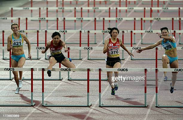 First placed Ayako Kimura from Japan and second placed from Khazakistan Anastassiya Soprunov Gebregeiorges cross the final hurdle in the women's 100...