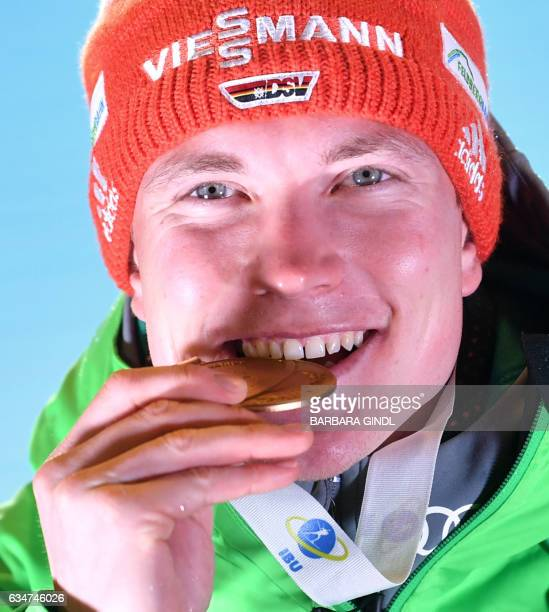 First placed Benedikt Doll of Germany celebrates with his medal at the ceremony after the IBU World Championships Biathlon Men's 10 km Sprint race in...