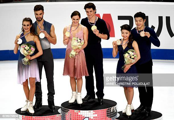 First placed Canadian Tessa Virtue and Scott Moir second placed French Gabriella Papadakis and Guillaume Cizeron and third placed US Maia Shibutani...