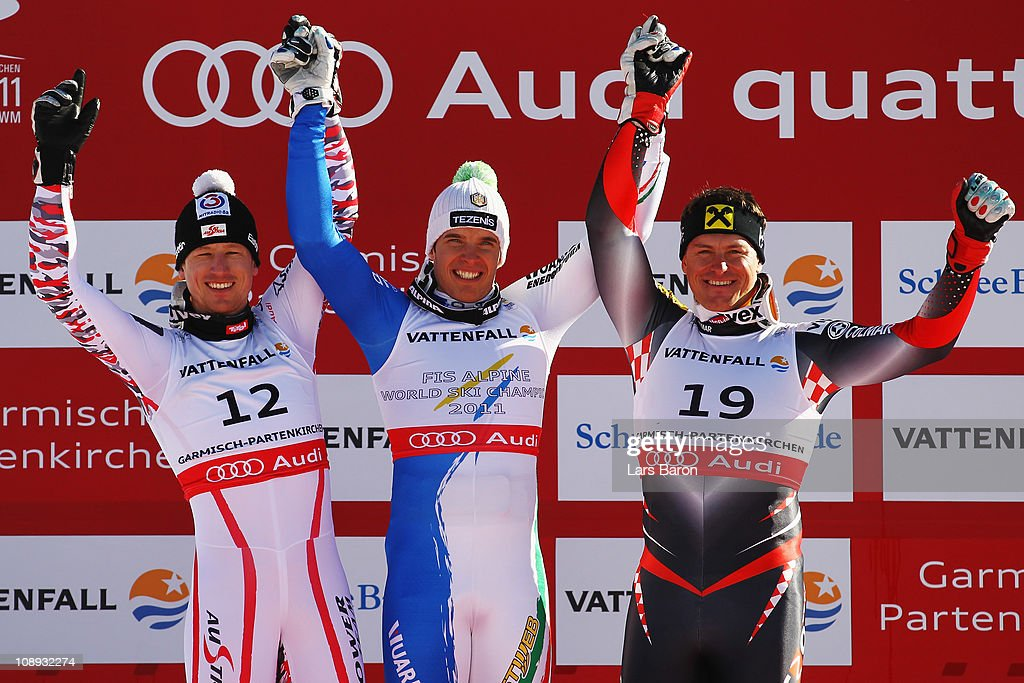 First placed Christof Innerhofer of Italy second placed Hannes Reichelt of Austria and third placed Ivica Kostelic of Croatia celebrate at the flower...