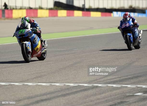 First placed EG 00 Marc VDS' Italian rider Franco Morbidelli and second placed Italtrans Racing Team's Italian rider Mattia Pasini cross the finish...