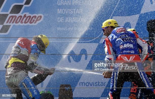 First placed EG 00 Marc VDS' Italian rider Franco Morbidelli and second placed Italtrans Racing Team's Italian rider Mattia Pasini celebrate on the...