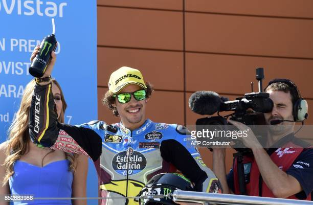 First placed EG 00 Marc VDS' Italian rider Franco Morbidelli celebrateS on the podium after the MOTO 2 race of the Moto Grand Prix of Aragon at the...