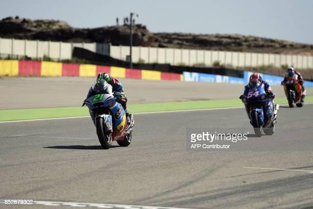 First placed EG 00 Marc VDS' Italian rider Franco Morbidelli second placed Italtrans Racing Team's Italian rider Mattia Pasini third placed red Bull...