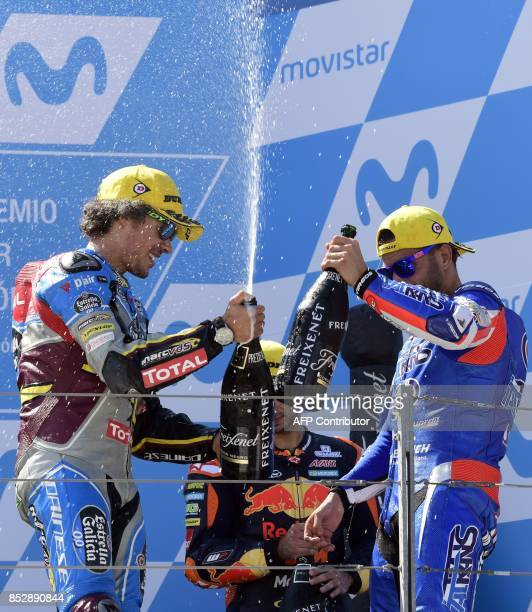 First placed EG 00 Marc VDS' Italian rider Franco Morbidelli second placed Italtrans Racing Team's Italian rider Mattia Pasini and third placed red...