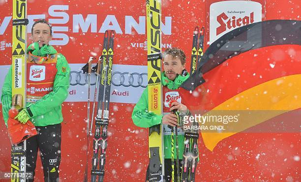 First placed Eric Frenzel of Germany and second placed Fabian Riessle of Germany pose at the nordic combined triple world cup on January 31 2016 in...