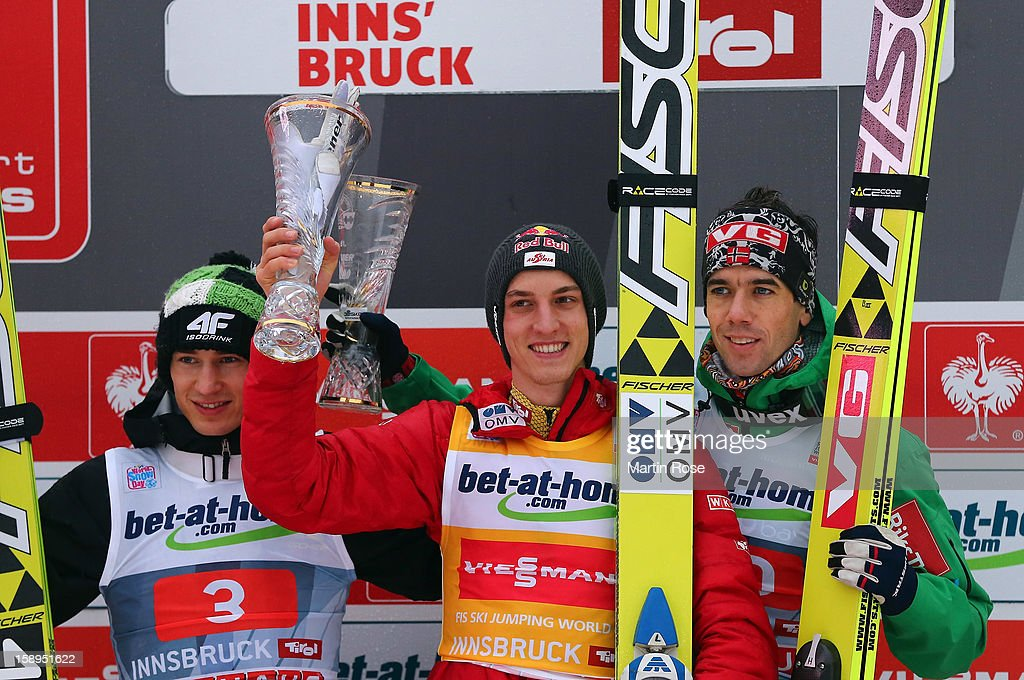 First placed Gregor Schlierenzauer of Austria (C) celebrate with 2nd placed Kamil Stoch (L) and 3rd placed Anders Bardal of Norway (R)during the final round for the FIS Ski Jumping World Cup event of the 61st Four Hills ski jumping tournament at Bergisel-Stadion on January 4, 2013 in Innsbruck, Austria.