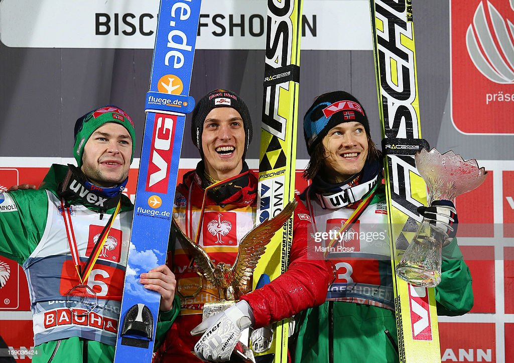 First placed Gregor Schlierenzauer of Austria celebrate with 2nd placed Anders Jacobsen of Norway and 3rd placed Tom Hilde of Norway during the final...