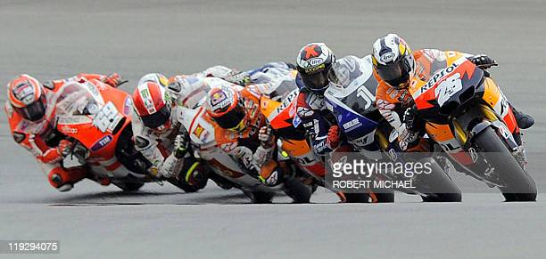 First placed Honda driver Dani Pedrosa of Spain drives ahead of the second placed Yamaha driver Jorge Lorenzo of Spain third placed Honda driver...