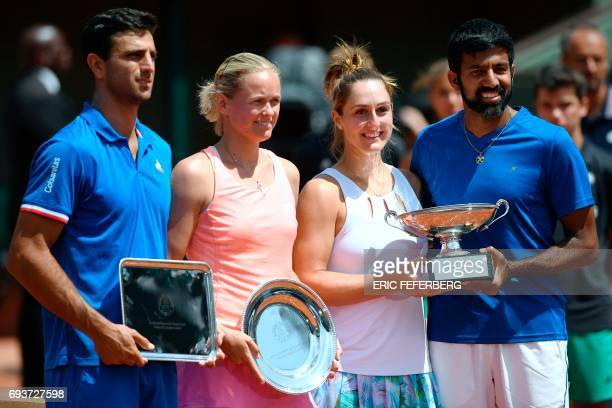 First placed India's Rohan Bopanna and Canada's Gabriela Dabrowski pose with their trophy next to second placed Colombia's Robert Farah and Germany's...