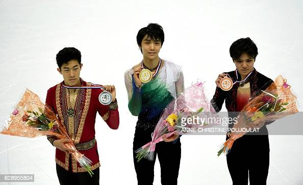 First placed Japanese Yuzuru Hanyu second placed US Nathan Chen and third placed Japan's Shoma Uno pose on the podium with their medals after...