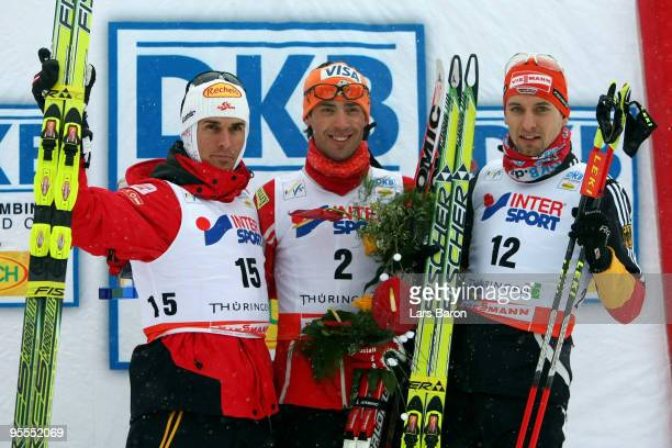 First placed Johnny Spillane of USA pose with second placed Felix Gottwald of Austria and third placed Bjoern Kircheisen of Germany after the cross...