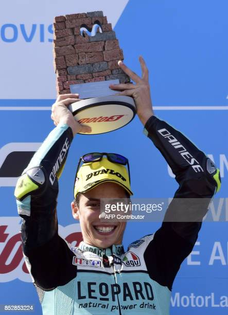 First placed Leopard Racing's rider from Spain Joan Mir celebrates on the podium after the MOTO 3 race of the Moto Grand Prix of Aragon at the...