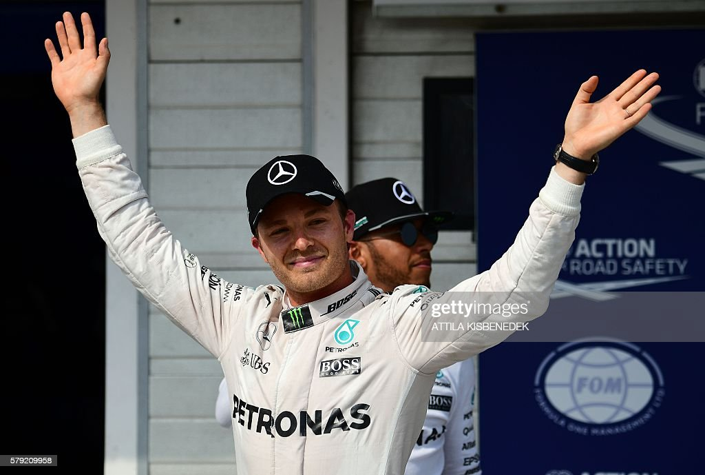 First placed Mercedes AMG Petronas F1 Team's German driver Nico Rosberg celebrates his pole position with his teammate second placed British driver...