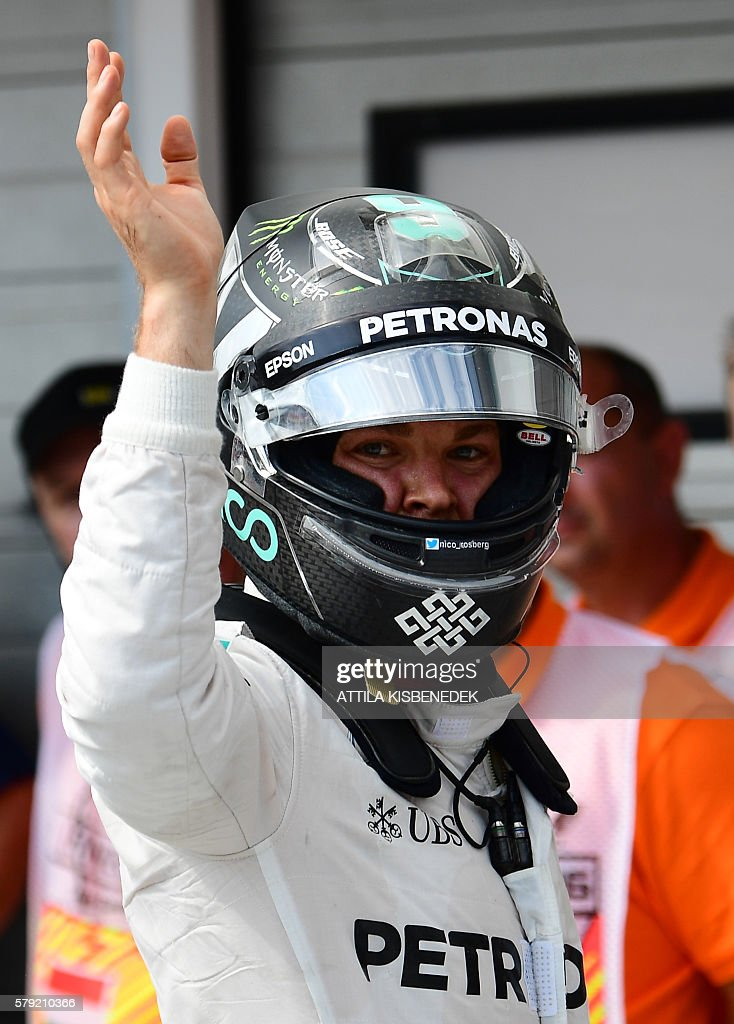 First placed Mercedes AMG Petronas F1 Team's German driver Nico Rosberg celebrates his pole position after the qualifying session for the Formula One...